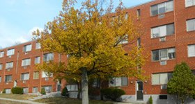 Apartment building with tree in front